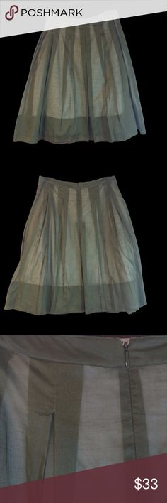 TALBOTS - Pleated Retro Style Olive Green Skirt Features:  Zipper and hook & eye back closure Set in waistband Wide hem Non-see-through underskirt  Fabric: Shell: Cotton: 100%  Lining: Cotton:  100%  Care: Machine wash. Tumble dry low.  Measurements are in inches.  Waist:  32 Hips:  46 Length: 25 Sweep:  48 Talbots Skirts Midi