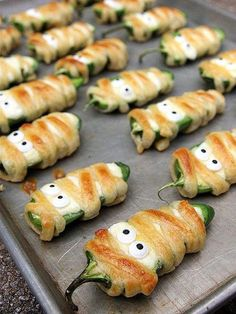 17 Creepy-Cute Treats to Make for Halloween | MUMMY POPPERS | Another savory mummified snack? These cheese-stuffed jalapeño poppers.