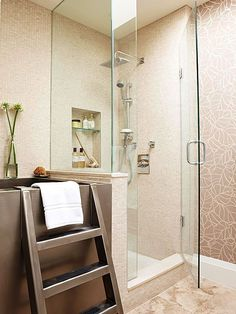 Enclose a walk-in shower with a seamless glass enclosure. The transparent barriers take up little visual space and let natural light flow between the bathroom and shower, which in turn makes a small bathroom live larger than its dimensions. This bathroom's neutral tiled walls continue into the walk-in shower to further the space-stretching illusion.