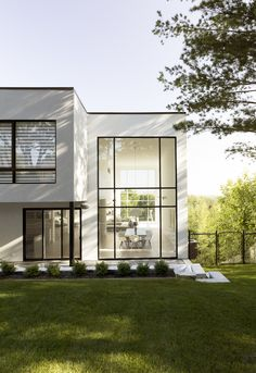 Simple black and white volumes form this home in Quebec City, which was built by local firm PARKA Architecture for a professional ice hockey player.