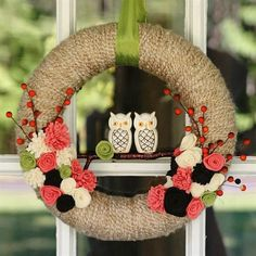A pair of cute owls is the centerpiece of this sweet, whimsical yarn-wrapped wreath from My So Called Crafty Life