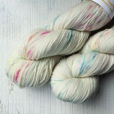 Tiny little sprinkles of colour on a sparkly sock weight yarn. So delicate and pretty I love dyeing this one. I've just added a few to the shop link in profile.
