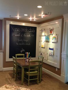 Basement idea....Kid's nook - love the framed chalk board and art display.  Maybe even better to put a table like this in her little sitting room off the BR with a framed chalkboard like this around it somehow?