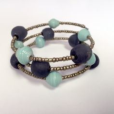 Black and Aqua Glass and Paper Bracelet by RisingVillage on Etsy