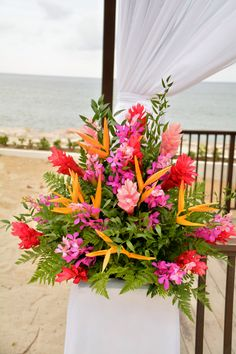 Keep the theme going with tropical flowers for your tropical wedding! #SecretsWIldOrchidStJames