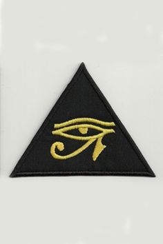 "The Eye of Horus is an ancient Egyptian symbol of protection, royal power and good health. The Eye of Horus Embroidered on a Black Triangular Patch. 4""×3"" yellow-gold Eye of Horus embroidered in a bla"