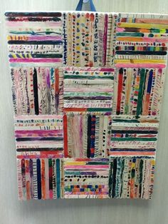 "Unique art project kids can make out of craft sticks. This one was made by a classroom of students as a ""community art project""--each child contributed pieces to make one beautiful art piece. Could be fun for a family project as well when talking about how important everyone's contributions are."