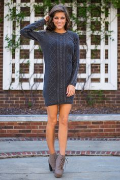 "I pine, you pine, we al-pine for this sweater dress!;) In a trendy faded black material with a snug fit, this sassy little number is prepared to take your look to the next level this fall! <br /> <br />Bra-friendly! Material has fair amount of stretch. <br />Miranda is wearing the small. <br /> <br />Length from shoulder to hem: S- 33""; M- 34""; L- 35""."