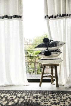 A black and white ambience with embroidered linen sheers and cushions. #Elitis #Sheer #Cushion #Linen