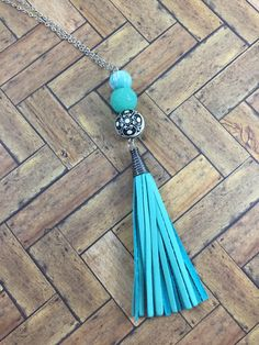 A personal favorite from my Etsy shop https://www.etsy.com/listing/456230242/handmade-teal-leather-tassel-acrylic-and