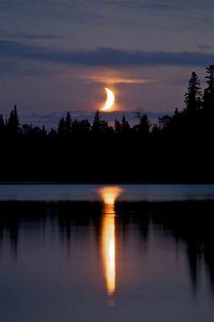 Moon setting in Garden Hill - Island Lake - Manitoba - Canada