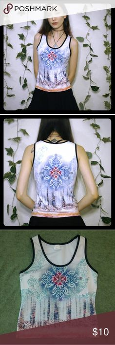 "Cute & Trippy Activewear Top! Cute and trippy activewear top! Has a built in bra! Super cute for jogging, yoga, hiking-looks good for anything! Super comfortable stretchy material! In good condition! I'm 5'6"" as a reference! So Sporty Tops Tank Tops"