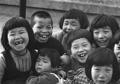 Children laughing, Koto, Tokyo, 1953 by Domon Ken