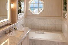 Simple marble bathroom in The Breakers designed by Bagle Mischka.
