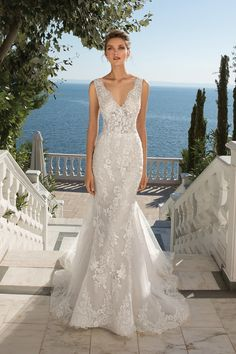 Feel like a bride in this fit and flare gown adorned in lace appliques that are delicately beaded throughout. Completed with a chapel length train with matching hem lace around. This style is also available with the front bodice lined to the side illusion inserts.