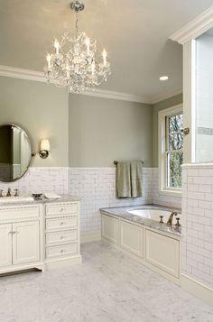 Suzie: Hendel Homes - Gorgeous green bathroom with sage paint color, subway tiles backsplash, ...