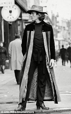 Michael Fish posing in a long coat in 1970. The classic fashion brand behind the 'kipper' tie, whose clothes were worn by David Bowie and Mick Jagger, is to be re-launched for a new generation of men in 2016. Mr Fish was a popular shirt maker and designer in the swinging 60s and the 1970s, creating flamboyant Austin Powers-style outfits (follow minkshmink on pinterest)