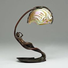 Art Nouveau Nautilus table lamp by C. BONNEFOND, French, late or early century. An art nouveau lamp w/ a bronze base of a reclining nymph on a lily pad and an iridescent shade in the shape of a nautilus shell, base signed C. Mobiliário Art Nouveau, Design Art Nouveau, Bronze, Muebles Estilo Art Nouveau, Arte Art Deco, Jugendstil Design, Art Nouveau Furniture, Art Nouveau Interior, Modernisme
