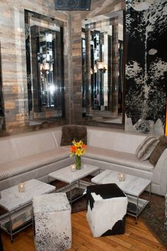 Part of our Lounge area. #parties #cowhide #interiordesign #mirrors #hardwoods #naturalwood