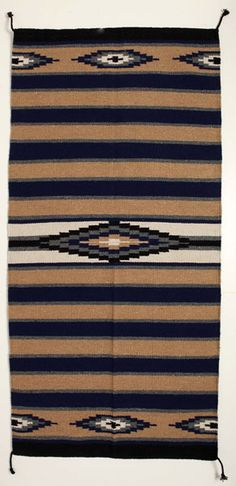 """This saddle blanket is made of quality acrylic material. Affordable style for everyday use. Measures 32"""" x 64"""". Designed, crafted, and distributed by El Paso Saddleblanket, our saddle blankets are handmade with the highest quality materials. By selling our Western tack and apparel wholesale direct, we are able to give you the best possible prices. Our saddle blankets are available in hundreds of styles."""