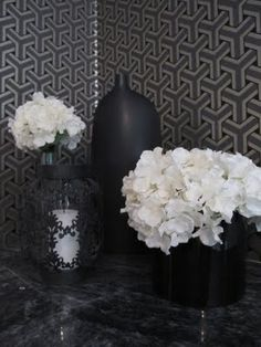 most of my house i envision in white, with black accents and pops of bold colors. would be a lovely contrast to swap it in a room or small space, i love how thse white flowers pop against the black.