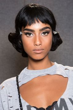 Each had a choppy fringe cut to flatter their face shape, but all sat above the brows. From what we've seen so far this season, micro-fringes are definitely having a moment.