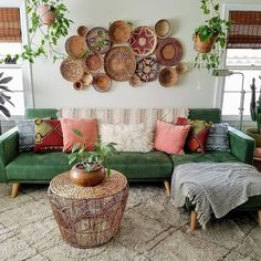 This lovely living space has so many layers of beautiful textiles in a large array of colors, lending a definite boho chic feel to the room. The woven rattan baskets on walls and hanging plants serves Bohemian Living Rooms, Bohemian Decor, Living Room Decor, Living Spaces, Bedroom Decor, Bohemian Design, Modern Bohemian, Bedroom Ideas, Style Deco