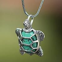 Symbol of patience and wisdom, a chelonian turtle centers this fascinating necklace by Nyoman Rena. It is crafted by hand of sterling silver with elaborate detail, featuring a reconstituted turquoise shell to resemble the green hue that makes Chelonia turtles unique.