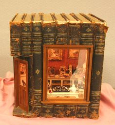 Miniature Jewelry store built into a set of books. Ode to Susan Harmon exhibited by Janey Elliot at the Spring 2009 Seattle Dollhouse Show.