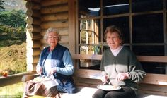 A world away from state banquets: The Queen and Margaret enjoy a relaxed lunch at Glen Beg, Her Majesty's log cabin on the Balmoral estate - with the Queen's gin and Dubonnet perched on the side