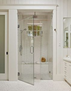 white subway tile, shower, marble seat, glass ventilation at top, steam room