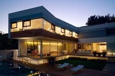 Diseño de Interiores & Arquitectura: Casa Contemporánea de dos Niveles en Israel con Forma de L.