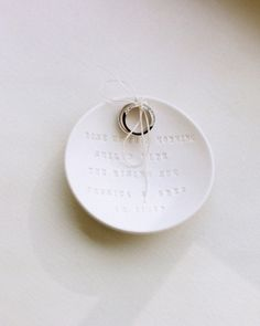 Love this idea: These wedding rings were carried down the aisle in a custom dish personalized with lyrics from the couple's first-dance song
