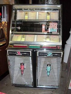 This was the first stereo jukebox ...the Seeburg 222 from 1959.  We have one and it works great!   It holds 160 45's.....kp