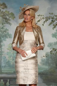 90398 (Condici) Ruched silk dress with matching jacket in Embellished Pearl & Soft Fawn. The dress has capped sleeves and beaded detailing under the bustline. The skirt is ruched with embroidered floral print. The length will sit below the knee. Read More...