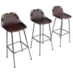 Charlotte Perriand Leather Bar Stools | From a unique collection of antique and modern stools at http://www.1stdibs.com/seating/stools/
