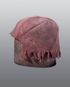 This cap was found during restoration work under the wooden floor of the choir screen, in a hollow of a cross vault, in the church of St. Leonhard, Basle. It had probably belonged to a stonemason. They were loosely knitted from woollen yarn, overlarge, and then shrunk and felted to their desired shape by washing in lye and mechanical milling.