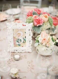 Love the background in the photo frame. Ties in beautifully with the rest of the centrepiece.