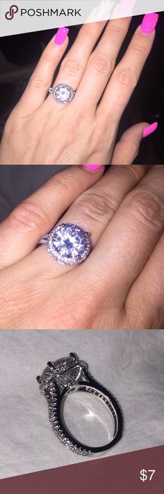 4k cubic zirconia ring Beautiful  cubic zirconia ring. 4 carat with halo. Costume jewelry! Looks like a real  Diamond ring. Jewelry Rings
