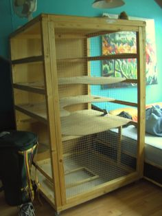 interesting DIY Ferret cage wood. The doors might need some redesigning but otherwise I love all the space this would give my buisness! <3