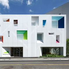 colourful recessed windows at Sugamo Shinkin Bank by Emmanuelle Moureaux