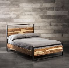 Taking the bedroom ambiance to new heights is easily accomplished thanks to this unique rosewood bed. Cool metal framing gives it an industrial feel and highlights the wood's natural contrasting colors.