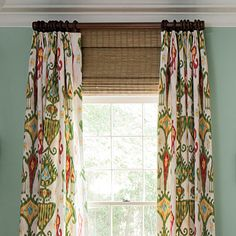 Ikat pattern curtains with triple Euro pleats and bamboo blinds