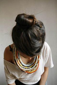 bun + necklaces.