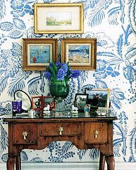 Beautiful hallway tablescape and walls in blue and white large printed wallpaper - Manuel Canovas's Lantana in blue and ivory