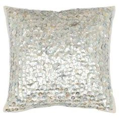 """Reminiscent of Old Hollywood style, this hand-woven linen and cotton pillow is adorned with pearlescent buttons for shimmering style.   Product: Set of 2 pillowsConstruction Material: Linen and cotton cover and polyester fillColor: Silver and ivoryFeatures: Hand-wovenPearlescent button accentsHidden zippered enclosureInserts includedDimensions: 18"""" x 18""""Cleaning and Care: Dry cleaning recommended"""