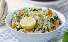 Quinoa is cooked in broth to infuse it with savory flavor, then tossed with aromatics, herbs, and roasted vegetables, then baked until warm and fluffy.