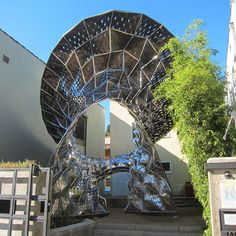 Metal that Breathes: Bloom Installation Made with 14000 Thermobimetal Pieces
