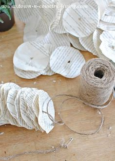 to Make a Book Page Garland How to make a book page garland.How to make a book page garland. Old Book Crafts, Book Page Crafts, Newspaper Crafts, Paper Book, Paper Art, Book Page Garland, Book Wreath, Recycled Books, Recycled Clothing