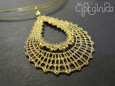 Bobbin lace pendant made out of metallic thread with small beads. Weightless jewelry appropriate both for everyday wear and for special occasions. DROP